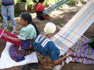 women artisans doing backstrap weaving