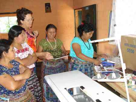 Mujeres Juaneras Receiving Sewing Machines and Equipment