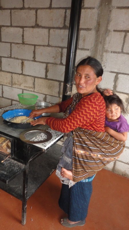 Vicenta cooking in her new kitchen!